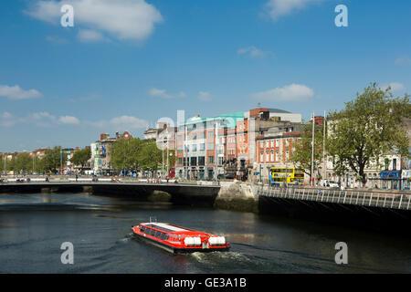Ireland, Dublin, River Liffey tour boat approaching 2014 Rosie Hackett Bridge - Stock Photo