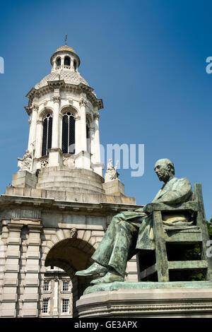 Ireland, Dublin, Trinity College, 1853 Campanile Bell tower & Irish Historian William Edward Hartpole Lecky Statue - Stock Photo