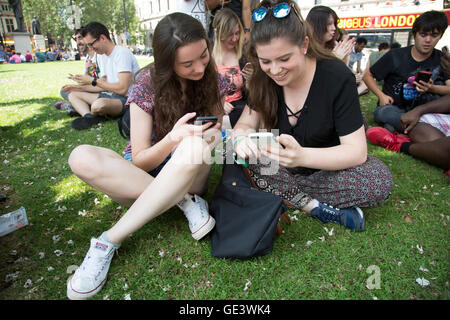 London, UK. 23rd July, 2016. Hundreds of enthusiastic gamers descend with their mobile devices on central London - Stock Photo