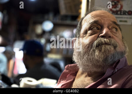 Rio de Janeiro, Brazil. 12th July, 2016. Alfredo Jacinto Melo sits in the music bar 'Bip-Bip' which is situated - Stock Photo