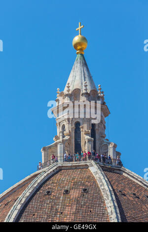 Florence, Florence Province, Tuscany, Italy.  The dome of the Duomo, or cathedral.  Visitors admire the city from - Stock Photo