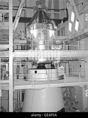 The Apollo 11 Command/Service Module (CSM) are being mated to the Saturn V Lunar Module Adapter on April 11, 1969. - Stock Photo