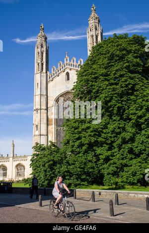 CAMBRIDGE, UK - JULY 18TH 2016: A cyclist rides past the magnificent facade of Kings College Chapel in Cambridge, - Stock Photo
