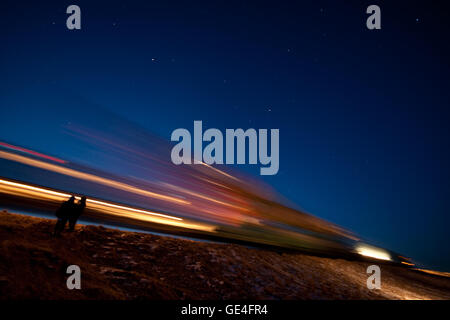 Description: The Soyuz TMA-17 spacecraft is seen in this long exposure as it is rolled out by train to the launch - Stock Photo