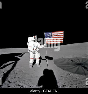 Astronaut Alan B. Shepard Jr., Apollo 14 Commander, stands by the U.S. flag on the lunar Fra Mauro Highlands during - Stock Photo