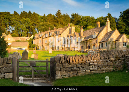 Setting sunlight on the town of Snowshill in the Cotswolds, Gloucestershire, England - Stock Photo