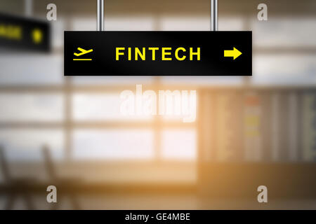 FINTECH or financial technology on airport sign board with blurred background and copy space - Stock Photo