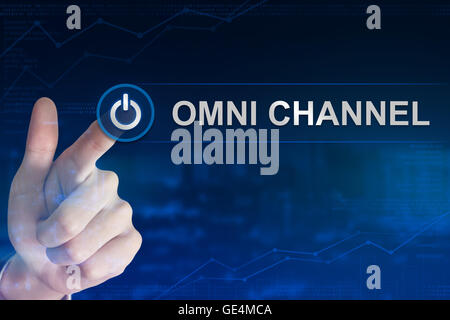 double exposure business hand clicking omni channel button with blurred background - Stock Photo