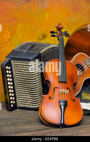 Violin, guitar and books on still-life wooden background - Stock Photo