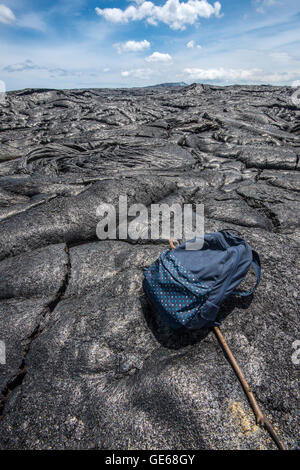 Backpack on the lava field in Hawaii - Stock Photo