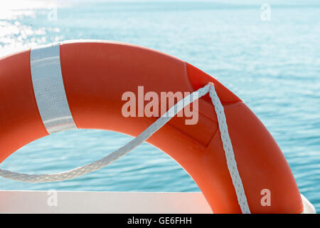 red lifesaver on a boat and sea background