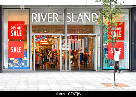 Sale discount posters in store windows at River Island clothing shop front & entrance in Oxford Street West End - Stock Photo