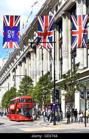 London new red routemaster double decker at bus stop outside Selfridges Department Store in Oxford Street London - Stock Photo