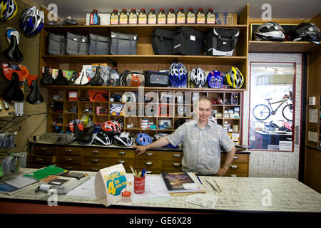 Dominique Leduc poses in his bicycle store in Amboise in France, 25 June 2008. - Stock Photo