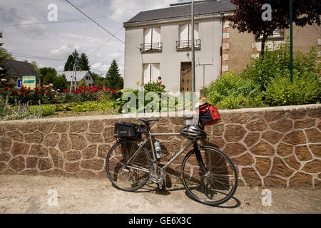 The bicycle of one of the participants in a Backroads cycle tour of the Loire Valley leans against an outdoors wall - Stock Photo
