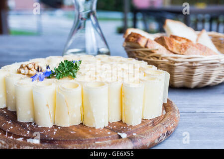 Etivaz cheese Etivaz Swiss cheese appetizer bread cheese cheese plate on a table cheese platter served with bread - Stock Photo