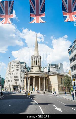 Union Jack flags near All Souls Church on Langham Place, London, UK - Stock Photo