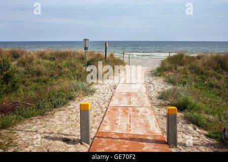Boardwalk to the beach at Baltic Sea in Jastarnia, small resort town on Hel Peninsula in Poland, Europe - Stock Photo