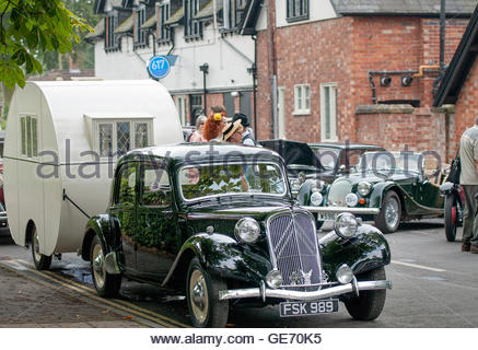 1955 Citroen Traction Avant - FSK 989 parked up with vintage caravan at the 1940's festival in Woodhall Spa - Stock Photo