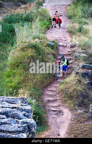 Pilgrims on a roman road near Cirauqui. Navarra. Spain. Camino de Santiago - Stock Photo