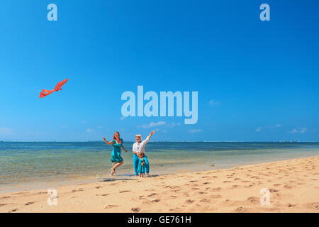 Happy family on beach - grandmother, mother and baby girl have fun, woman run along sea surf with water splashes - Stock Photo