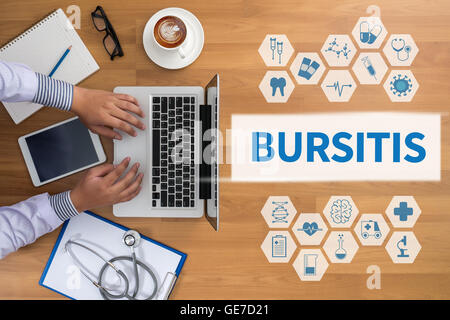 BURSITIS Professional doctor use computer and medical equipment all around, desktop top view, coffee - Stock Photo