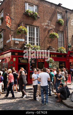 Ireland, Dublin, Temple Bar, customers drinking in road outside pub - Stock Photo