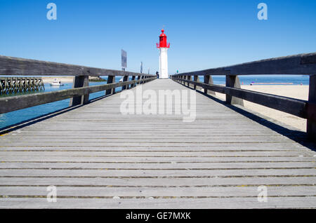 Sun parched jetty leading up to the Trouville lighthouse in Normandy, France - Stock Photo