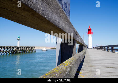 Sun parched jetty leading up to the Trouville lighthouse in France - Stock Photo
