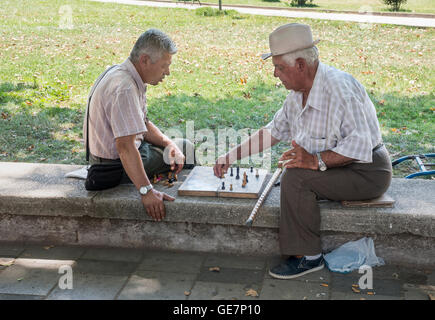 Playing chess, a popular passtime in Albania, on the edge of Rinia Park, Central Tirana, Albania, - Stock Photo