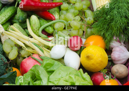 group of fresh vegetables and fruits on table - Stock Photo