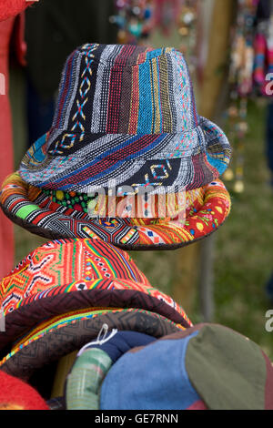 Hat Stand full of colorful woven hats - Stock Photo