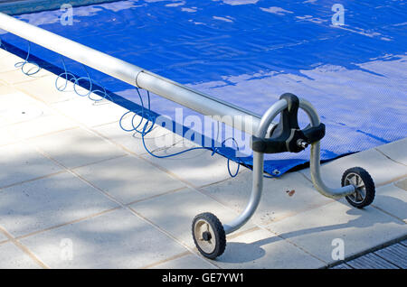 Domestic Swimming Pool With Blue Solar Bubble Wrap Cover