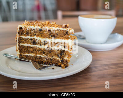 Carrot cake with walnuts on wooden table. selective focus - Stock Photo