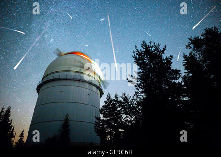 Rozhen astronomical observatory under the night sky stars. Blue sky with hundreds of stars of the Milky way. Bulgarian - Stock Photo