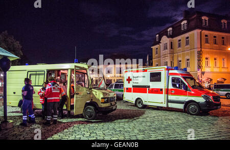 Ansbach, Germany. 25th July, 2016. Emergency service are on standby near the crime scene after a bomb attack in - Stock Photo