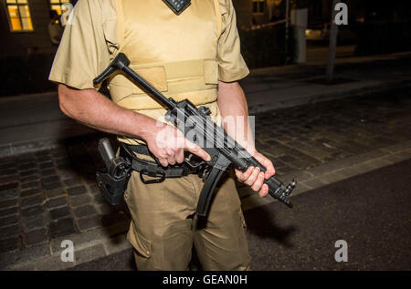 Ansbach, Germany. 25th July, 2016. A member of the German police secures the crime scene after a bomb attack in - Stock Photo