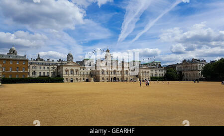 London, UK Weather 25 July 2016 - People enjoy a warm sunny day in Horse Guards Parade, Westminster. - Stock Photo