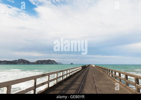 New Zealand, North Island, East Cape Region, Tolaga Bay, historic Tologa Bay Wharf, South Pacific Ocean, area of - Stock Photo