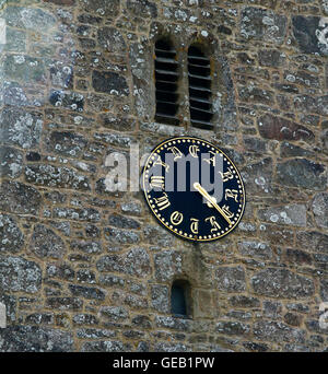 Saxon church at Buckland-in-the-moor with the famous clock face 'My Dear Mother' commissioned by the Whiteley family - Stock Photo