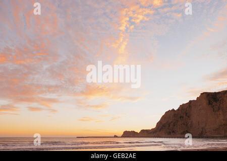New Zealand, North Island, East Cape Region, Tolaga Bay, sunrise, historic Tologa Bay Wharf, South Pacific, area - Stock Photo