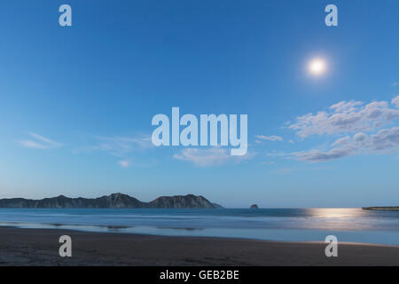 New Zealand, North Island, East Cape Region, Tolaga Bay, full moon, moonlight reflecting on ocean, South Pacific - Stock Photo