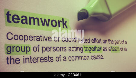 Definition of teamwork, highlighted in colour. - Stock Photo