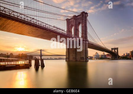 Brooklyn Bridge in New York City at sunrise. - Stock Photo