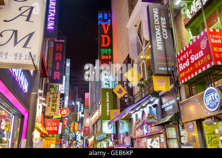 SEOUL, SOUTH KOREA - FEBRUARY 14, 2013: Neon signs line the Myeong-Dong nightlife district in Seoul. - Stock Photo