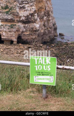 Samaritans notice above cliffs at Marsden, Tyne and Wear, England, UK - Stock Photo