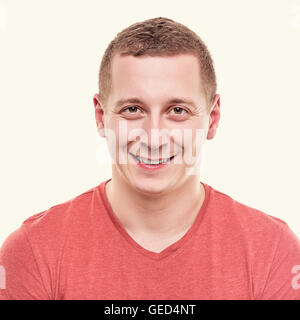 Man is looking straight and smiling. Toned photo. - Stock Photo