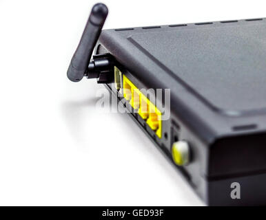 black DSL router back side anterna four port in a white background - Stock Photo