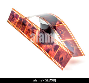 35mm film negative and roll container on white background - Stock Photo