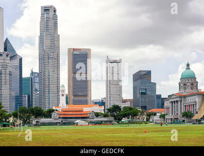 Singapore, Singapore - March 1, 2016: Skyline of One Raffles Place and UOB Building with Old Supreme Court and Victoria - Stock Photo